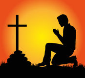Man praying before the crucifix Royalty Free Stock Photos