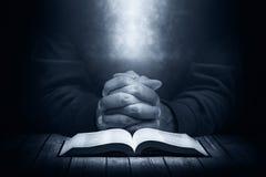 Man praying in the dark Royalty Free Stock Photos