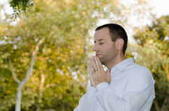 Man praying on a fall/autumn day. Stock Photos