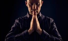 A man praying. Royalty Free Stock Image