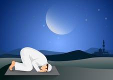 Man praying full moon background Stock Image