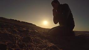 Man praying god sunset sitting silhouette sun sunlight the religion stock video