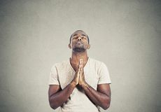 Man praying hands clasped hoping for best Stock Photos