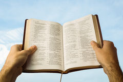 Man praying with his bible Stock Image