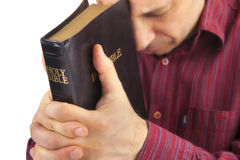 Man Praying Holding the Bible Royalty Free Stock Images