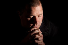 A man praying with holy light Royalty Free Stock Images
