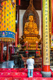 Man praying  in the The Jade Buddha Temple shanghai china Royalty Free Stock Images