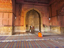 Man praying in the mosque Jama Stock Photo