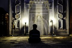 Man praying in mosque royalty free stock image