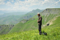 Man praying in mountains Stock Photography