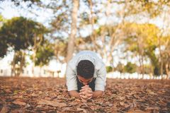 Man praying outdoors