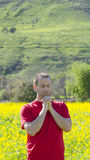 Man praying outside in nature alone. Royalty Free Stock Images