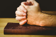 Man praying over his bible Stock Photography