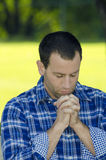 Man praying in a park Stock Photography