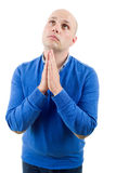 Man praying. Portrait of a religious expressive man praying in studio on white isolated background royalty free stock images