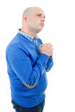 Man praying. Portrait of a religious expressive man praying in studio on white isolated background royalty free stock photo