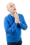 Man praying. Portrait of a religious expressive man praying in studio on white isolated background royalty free stock photography