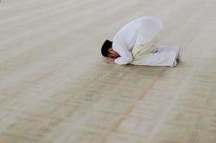Man praying. Man prostrating during prayers Royalty Free Stock Photo