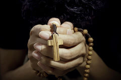 Man praying with rosary Stock Photo