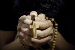 Man praying with rosary Stock Photo