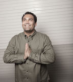 Man praying and smiling Royalty Free Stock Photo