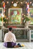 Man praying at the Sule Paya Pagoda in Yangon Stock Photo
