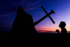 Man praying sunset Royalty Free Stock Photos