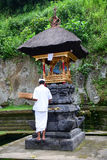 A man praying at the temple in Bali, Indonesia stock image