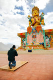 Man praying in Tibetan Buddhist temple of Maitreya in Ladakh, India Royalty Free Stock Photography
