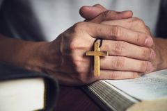 Man Praying to God with a Bible in the Morning Devotion.  royalty free stock images