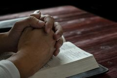 Man Praying to God with His Bible, Prayer with Reading the Bible. On the Wood Table royalty free stock photos
