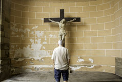 Man praying to jesus. In christian church, religion and faith Royalty Free Stock Images