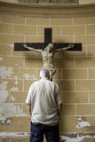 Man praying to jesus. In christian church, religion and faith Royalty Free Stock Image