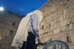 People praying to their religion at the Wailing Wall or Kotel in historic old city of Jeruslam. Man praying to their religion at the Wailing Wall or Kotel in stock image
