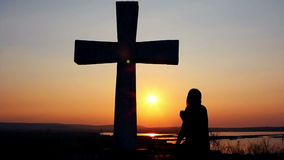 Man praying under the cross stock footage