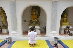 Man prays in front of the Buddha statue n Nakhom Pathom, Thailand. Royalty Free Stock Images
