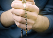 Man prays with a rosary Royalty Free Stock Photos