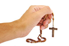 Man prays with a rosary in hands isolated on white Royalty Free Stock Photography