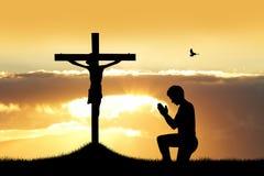 Man prays at sunset Royalty Free Stock Photography