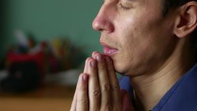 Man prays to God. Christianity is a religion. indoor prayer stock video