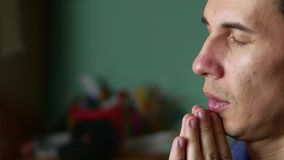 Man prays to God. Christianity is a religion. prayer indoor stock footage