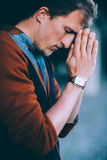 Man prays to God Stock Photo