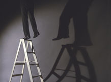 Man Precariously On Ladder Stock Photos