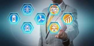 Man Predicting Growth For Energy Battery Storage. Investor predicting future growth for the stationary energy battery storage market for wind power. Industry stock images