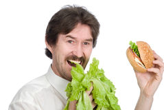 Man prefers salad instead of hamburger Royalty Free Stock Images