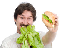 Man prefers salad instead of hamburger Stock Photo
