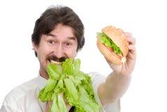 Man prefers salad instead of hamburger Stock Photo