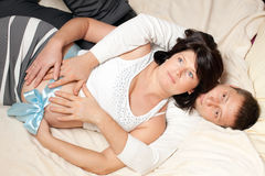 The man and the pregnant woman in a bed royalty free stock image