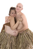 Man and pregnant woman in a dress made of straw Royalty Free Stock Photography