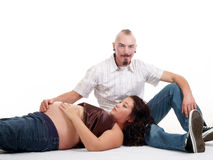 Man with pregnant woman hand on belly Royalty Free Stock Photo